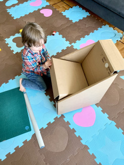 Design and construct a cardboard chair that you (or your child) can sit on using only cardboard. No glue or tape